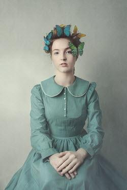 Anna Buczek Teenage girl in blue dress with butterflies in hair