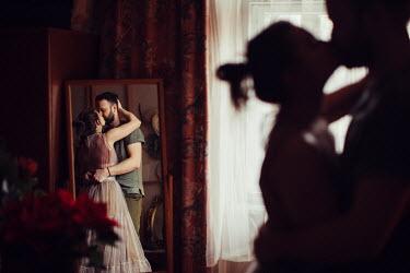 Marta Syrko Couple kissing by mirror