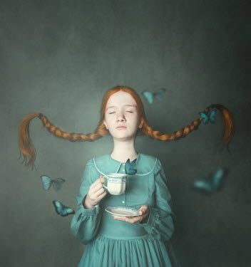 Anna Buczek Girl with pigtails holding tea cup