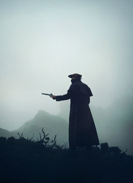 Mark Owen Pirate in hat and coat with pistol on hill