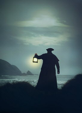 Mark Owen Pirate in hat and coat with lantern by beach