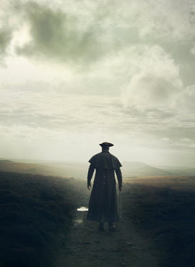 Mark Owen Pirate with hat, coat, and cane walking on hill
