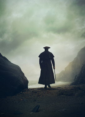 Mark Owen Pirate in hat and coat walking on beach