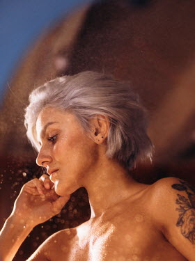Marta Syrko Topless woman with dyed hair