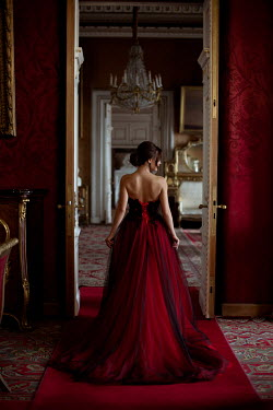 Alina Zhidovinova Young woman with red gown in mansion