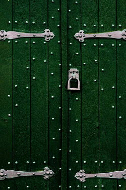 Maria Petkova Green gate with wrought iron hinges