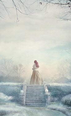 Drunaa Victorian woman on garden steps in winter