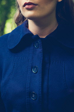Marie Carr Close up of woman's blue coat