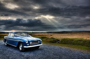 Maggie McCall Blue vintage car on rural road