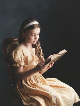 Elisabeth Ansley Girl in vintage yellow dress reading