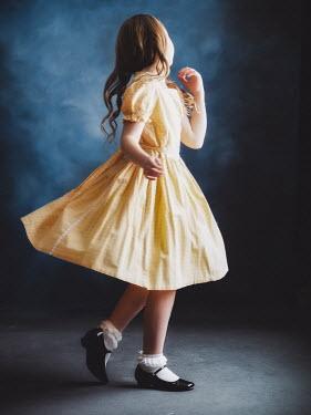 Elisabeth Ansley Girl in vintage yellow dress spinning