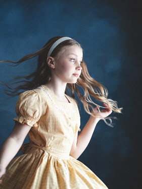 Elisabeth Ansley Girl in vintage yellow dress spinning