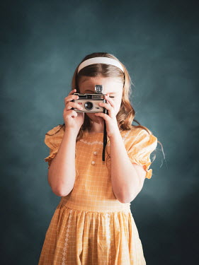 Elisabeth Ansley Girl in vintage yellow dress with camera