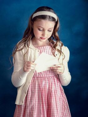 Elisabeth Ansley Girl in vintage sweater holding envelope