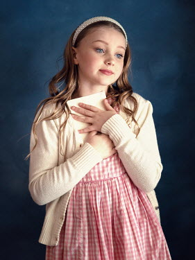 Elisabeth Ansley Girl in vintage sweater holding love letter