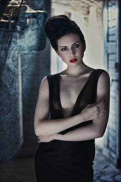 Beata Banach Young woman in black dress and red lipstick