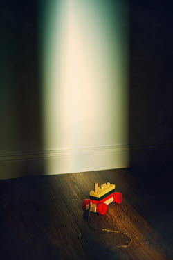 Magdalena Russocka Wooden train toy in empty room at night