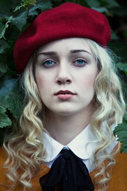 Magdalena Russocka Young woman in red beret by bush