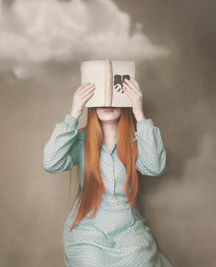 Anna Buczek Girl in vintage dress covering eyes with book