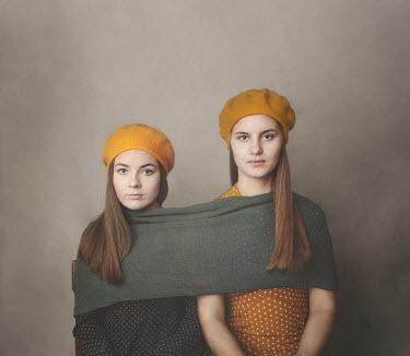 Anna Buczek Teenage girls in yellow berets sharing a scarf