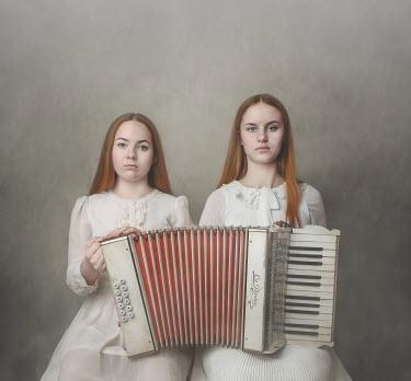 Anna Buczek Teenage girls in white dresses with piano accordion