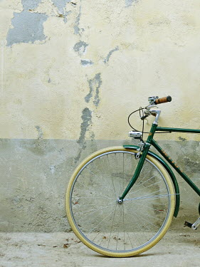 Giovan Battista D'Achille Bicycle by weathered concrete wall
