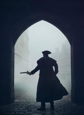 Mark Owen Man in coat and tricorne hat with pistol under arch