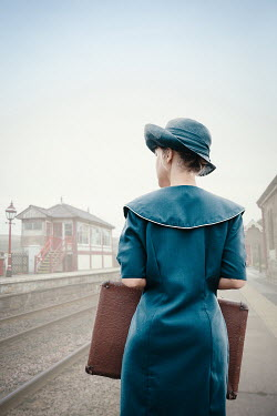 Natasza Fiedotjew Vintage lady with suitcase at train station