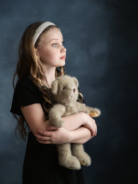 Elisabeth Ansley Girl in black vintage dress holding teddy bear