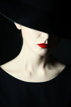 Magdalena Russocka close up of elegant woman in black hat