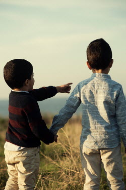 Mohamad Itani TWO LITTLE BOYS HOLDING HANDS WATCHING SEA Children