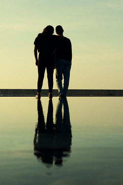 Mohamad Itani MAN AND WOMAN HUGGING BY SEA AT DUSK Couples