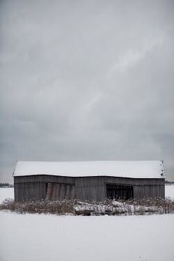 Patty Maher OLD WOODEN BARN IN SNOW Houses