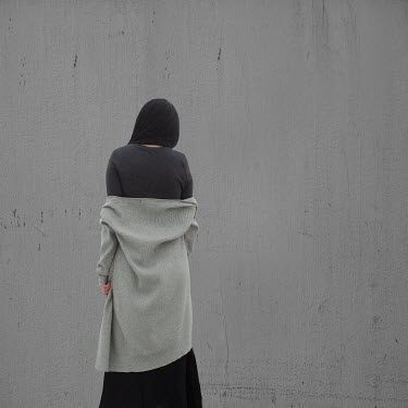 Patty Maher BRUNETTE WOMAN WITH GREY CARDIGAN FROM BEHIND Women