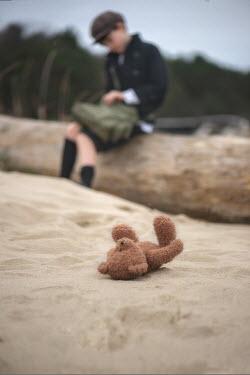 Galya Ivanova BOY SITTING ON BEACH WITH ABANDONED TEDDY Children