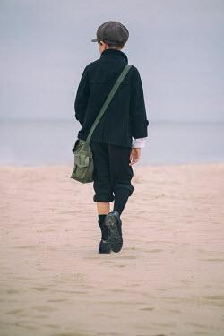 Galya Ivanova BOY IN CAP WALKING ON BEACH FROM BEHIND Children