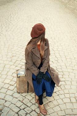 Svetoslava Madarova GIRL SITTING ON SUITCASE IN COBBLED STREET Women