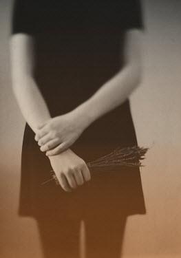 Elle Moss GIRL STANDING HOLDING BUNCH OF LAVENDER Women