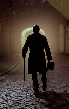 Jaroslaw Blaminsky MAN CARRYING TOP HAT AND CANE IN STREET AT NIGHT Men