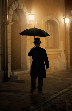 Jaroslaw Blaminsky MAN IN TOP HAT WITH UMBRELLA IN CITY AT NIGHT Old People