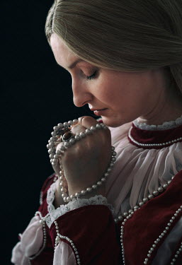 Jaroslaw Blaminsky close up of historical woman praying Women