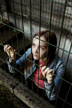 Kelly Sillaste SAD GIRL BEHIND RAILINGS IN CITY Children