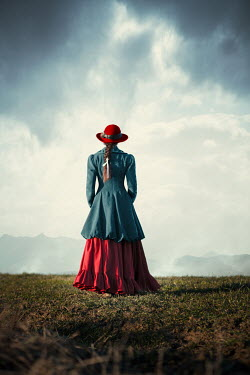 Magdalena Russocka historical woman standing in countryside with mountainscape