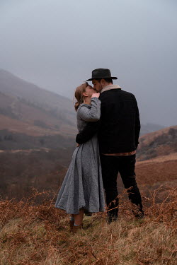 Rekha Garton COUPLE KISSING IN MISTY LANDSCAPE Couples