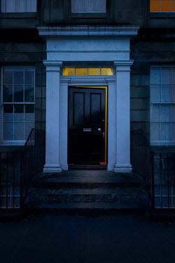John Cooper OPEN DOOR IN HISTORICAL HOUSE AT DUSK Houses