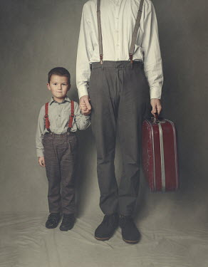 Anna Buczek FATHER AND SON HOLDING HANDS WITH SUITCASE Children