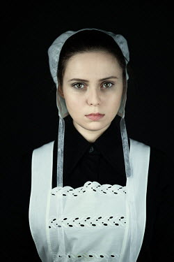 Magdalena Russocka historical woman in white bonnet and apron