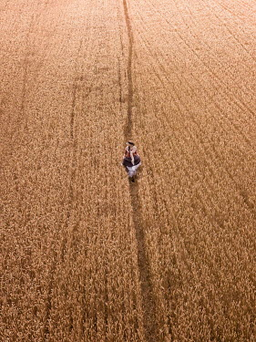 Mary Wethey HISTORICAL WOMAN IN WHEAT FIELD FROM ABOVE Women