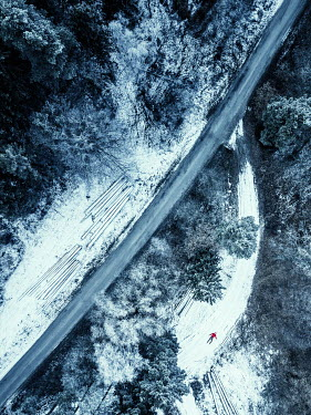 Magdalena Russocka Man's body in snowy forest from above