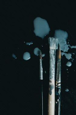 Isabelle Lafrance Paint brushes with gray paint